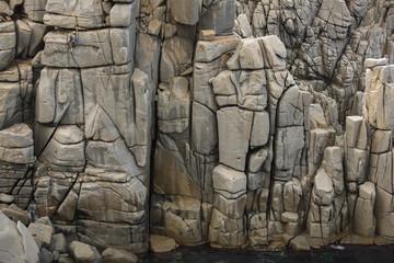 Girl climbing trad route in Capo Pecora, Sardinia, Italy