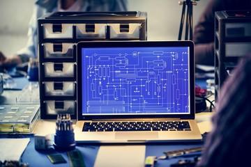 Computer laptop showing electronic circuit pattern
