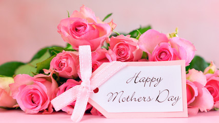 Pink roses on pink wood table, Happy Mother's Day background closeup.