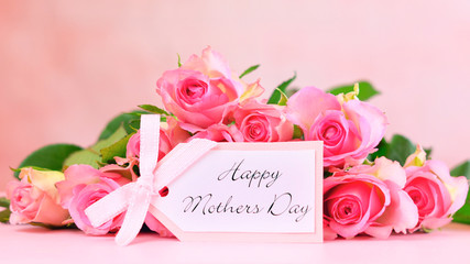 Pink roses on pink wood table, Happy Mother's Day background closeup with gift card