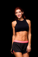 Sporty beautiful woman doing fitness exercising at black background to stay fit. Fitness workout motivation.