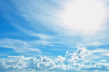 Blue sky and white clouds floating in the air. See the sun shining brightly on a clear day. Happy day