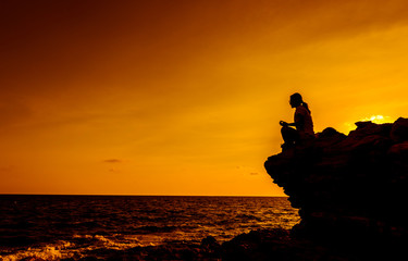 Silhouette woman yoga on the mountain sunset. Sport and healthy lifestyle.