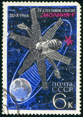 Ukraine - circa 2018: A postage stamp printed in Soviet Union show telecommunication artificial satellite of the Earth Molniya. Series: Space Achievements. Circa 1966