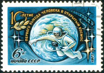 Ukraine - circa 2018: A postage stamp printed in Soviet Union show cosmonaut hovers in outer space and inscription 10th Anniversary of the First Space Walk. Circa 1975