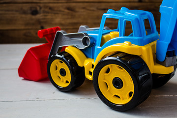 children toys tractor on wooden background