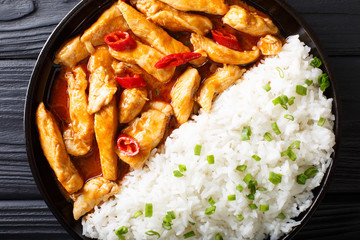 Thai food: Panang curry with rice close-up. horizontal top view from above