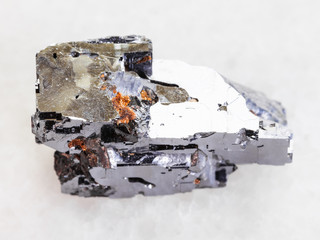 Galena crystal stone on white marble