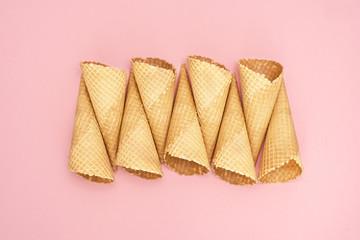 Ice cream cones on pink background