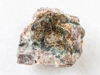 rough Delhayelite stone on white