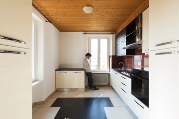 Lonely man in the kitchen, frontal view