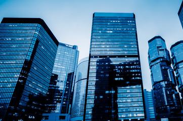 China,Hong Kong,modern skyscrapers,blue toned.