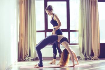 girl athlete doing bridge / yoga, professional gymnast, stretching and yoga trainer