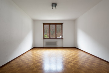Large empty room with windows