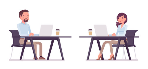 Smart casual man and woman working at desk