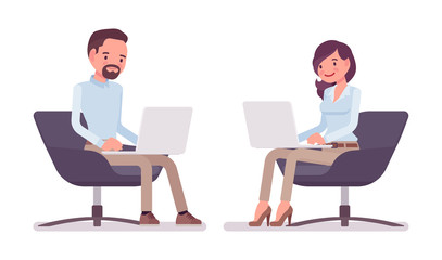 Smart casual man and woman sitting with laptop