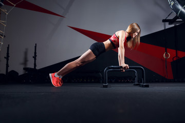 Image of sports woman doing exercise bar