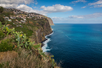 Cliff over the Atlantic ocean in Ribeira Brava on the Madeira island, Portugal