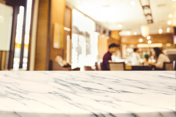 Empty marble Stone table top and blurred restaurant interior background with vintage filter -