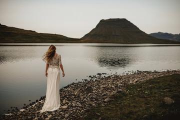 Woman in dress at lake