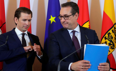 Austria's Chancellor Kurz and Vice Chancellor Strache leave a news conference after a cabinet meeting in Vienna