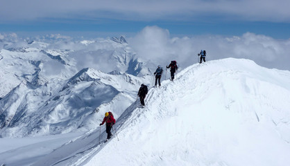 group of backcountry skiers on a ski mountaineering tour in the Austrian Alps heading to the summit of Grossvenediger