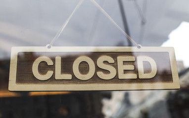 Close up shot of a closed sign hanging up