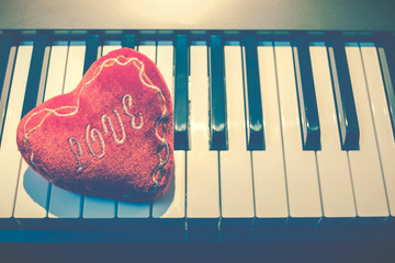 heart on piano keys, vintage filter. music background