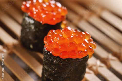 Macro shot of sushi, sashimi, uramaki and nighiri  typical