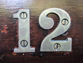 Written Wording in Distressed State Typography Found Number Twelve, 12