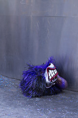 Basel carnival. Ringgaesslein, Basel, Switzerland - February 21st, 2018. Close-up of a beautiful purple colored carnival mask.