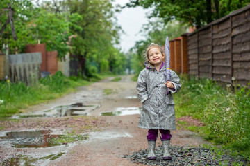 summer walk in the rain little girl with an umbrella