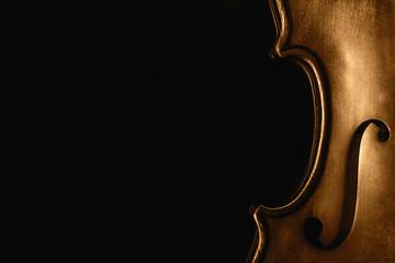 Half of a violin on a black background