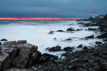 A red sunrise on the coast of Maine.