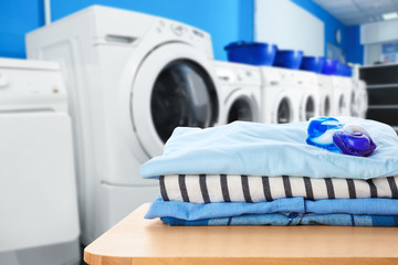 Clean clothes with gel pods at self-service laundry