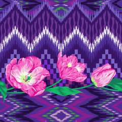 Ethnic seamless pattern with beautiful flowers. Tribal zigzag design. Ikat endless texture in purple, lilac, pink colors. Beautiful ethnic print perfect for home decor, wallpaper, fashion and bedding.