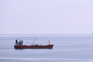 A ship tanker stands without traffic, a ship on a blue sky background