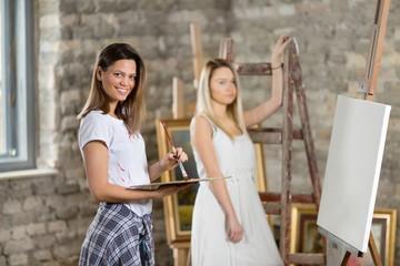 Female artist preparing to start painting