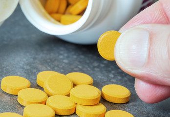 Wall Mural - turmeric tablets, a natural food supplement with multiple virtues