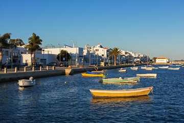 Evening view of the fishing village of Santa Luzia, Portugal
