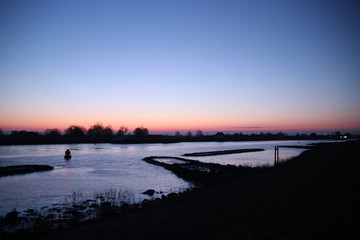 Sunrise above frozen river Hollandse IJssel in the Netherlands