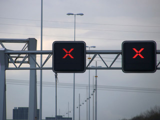 Red cross avove lanes on the dutch motorway, no trespassing allowed when this cross is on the lane