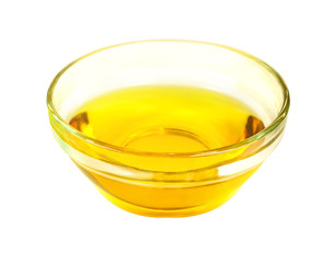Side view of vegetable transparent golden oil in glass bowl isolated on white background