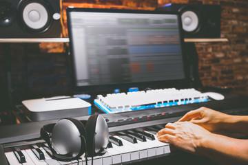 headphone on midi piano in home studio