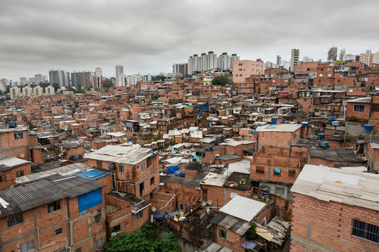 """""""Paraisopolis"""" shanty town with high standard buildings in the background."""