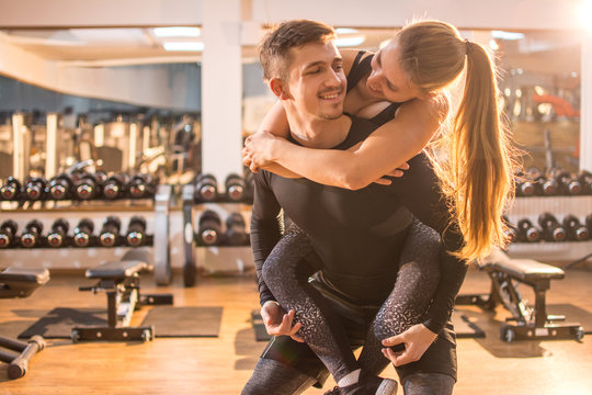 Beautiful sporty couple in gym.