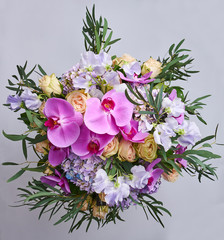 Bouquet of flowers isolated on purple background. Beautiful photo collage for floral design and card celebration.
