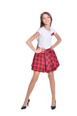 Happy little girl wearing high heels posing  isolated