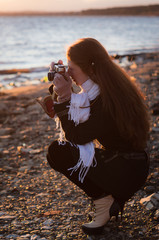 A girl photographer with an old camera