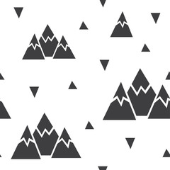 Vector seamless pattern made of mountains and triangles.